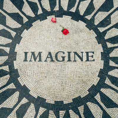Aerial view of the word Imagine in circular tiles with a rose in memory of John Lennon, a famous singer-songwriter