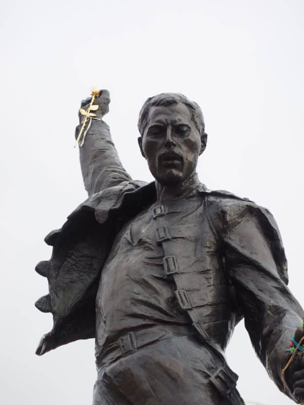 Statue of Freddie Mercury from Queen striking a flamboyant pose